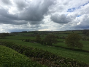 Pedalling through the Derbyshire countryside, dark clouds looming
