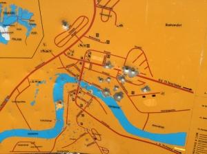 Road side map with bullet/shotgun pellet holes, a little concerning