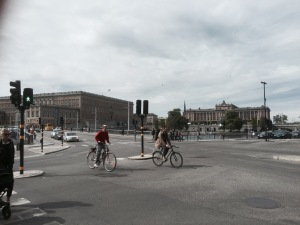Cyclists abound - parliament building in background