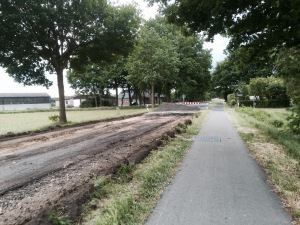 Road being resurfaced but cycle path open