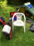 Campsite owner brought me chair - massive luxury for a cycle tourer