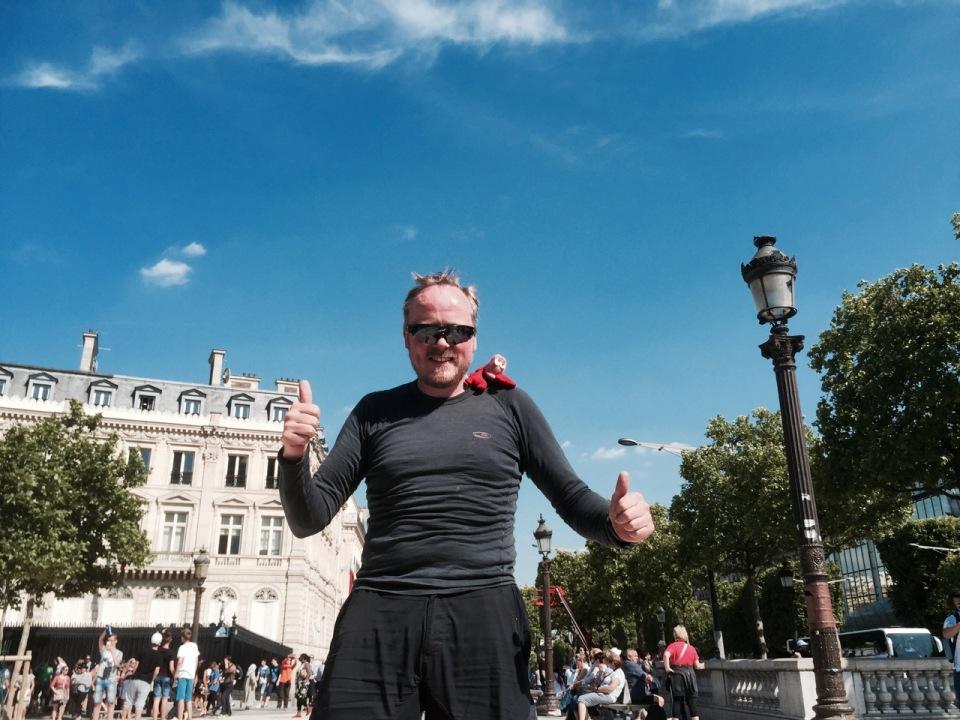 Double thumbs up post cycling up Les Champs-Élysées