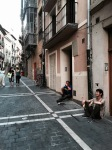 Sitting in the street in Pamplona is the done thing