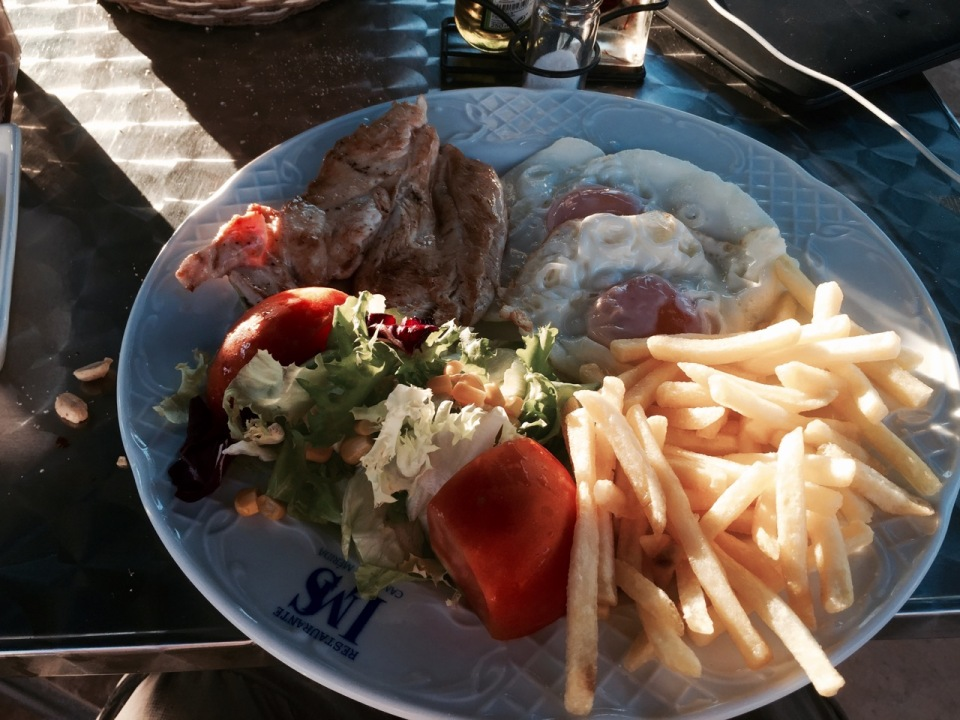 Standard campsite menu - chicken or pork, chips, eggs and salad