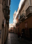 Narrow street in Cadiz, shade and sunlight