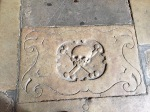 Skull and crossbones motif on cloisters flagstone