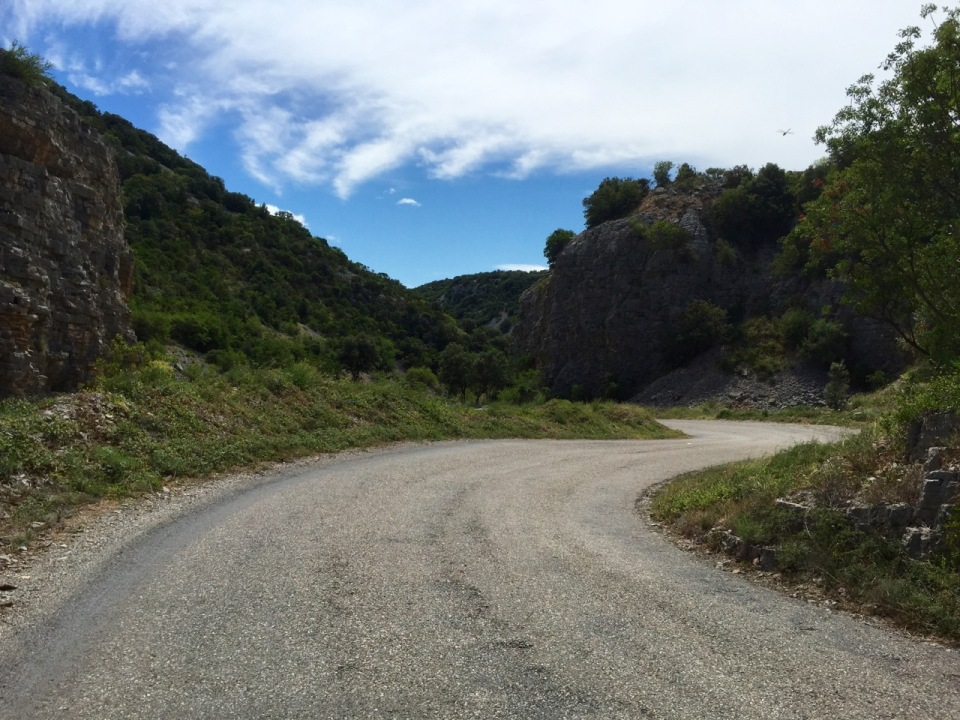 Road ascends through a canyon