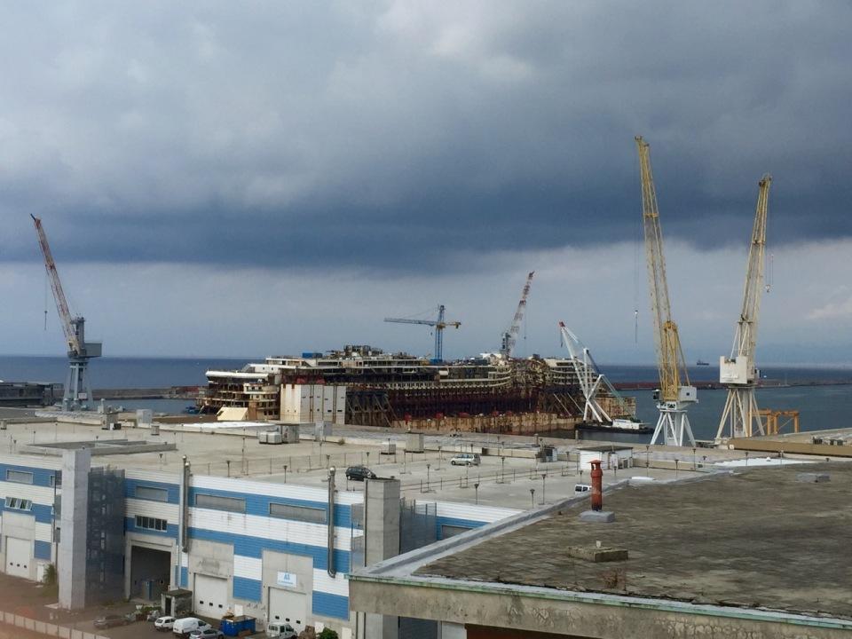 Docks, Geno; huge cruise ship being dismantled