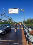 Private metal bridge over river; free for cyclists
