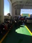Smaug on board; keeping motorbikes company