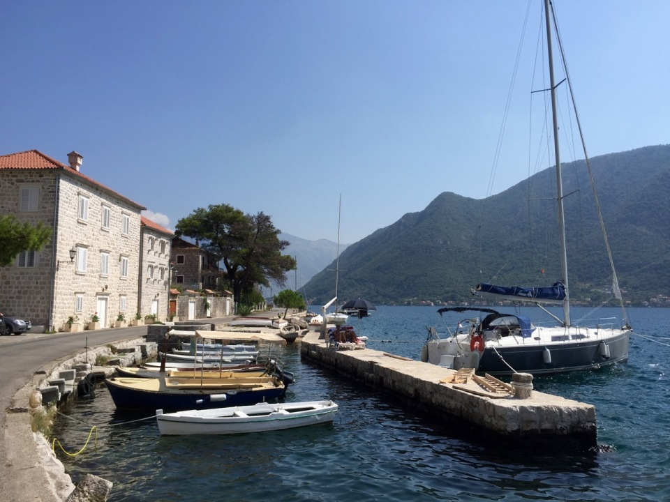 Few yachts moored up in Perast