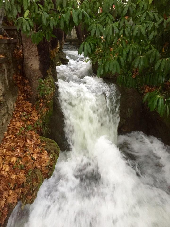 Water flowing pretty fast towards waterfall
