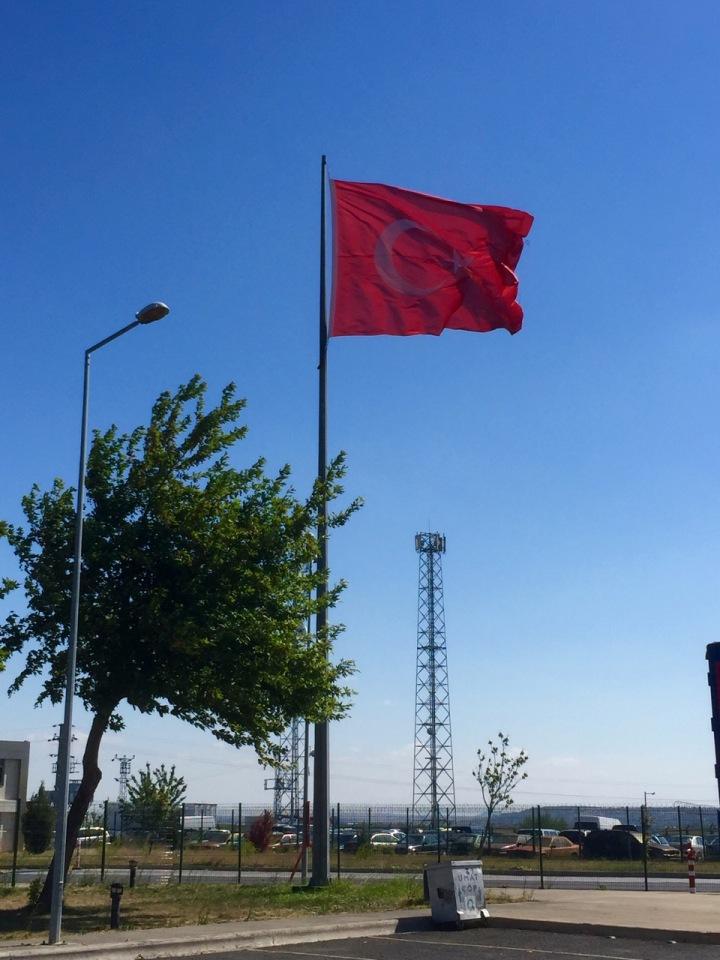 Many large Turkish flags flying