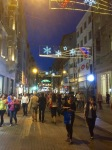Main shopping street awash with people, late into the night