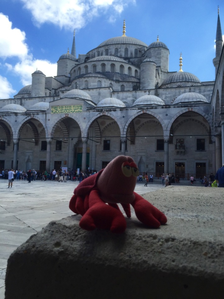 Lobster posing in front of Mosque