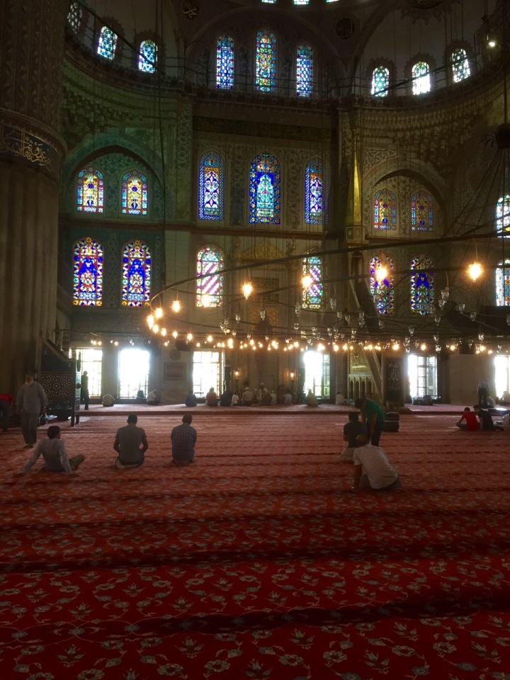 Many visitors to mosque, some saying prayers