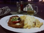 Snitzel and chips, with cheese; most things come with cheese here