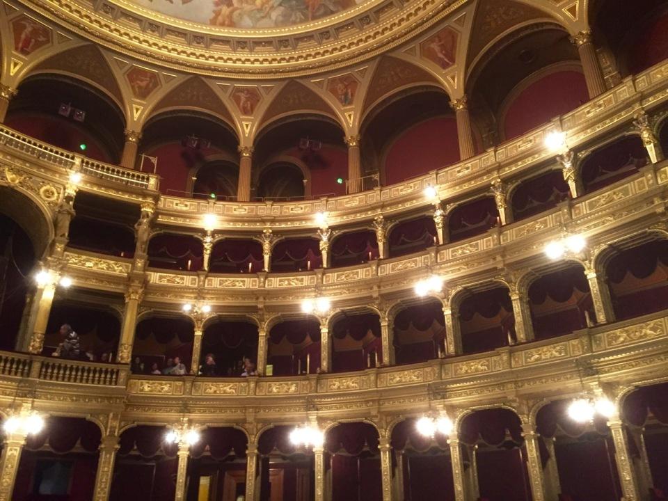 Masses of gold leaf in auditorium