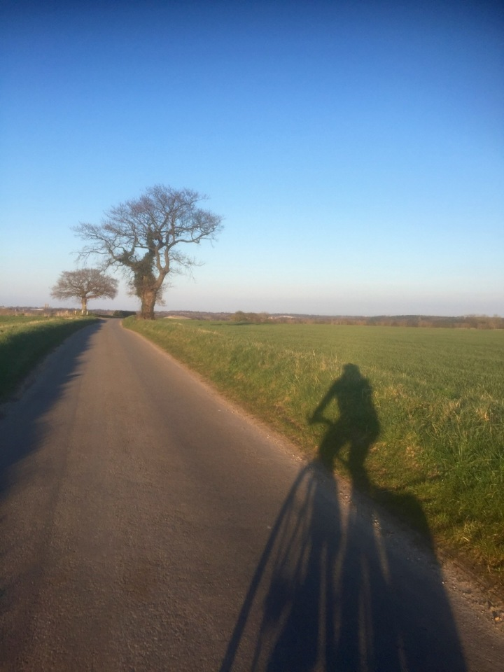 Me cycling with my shadow