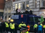 Protestors get on top of lorry