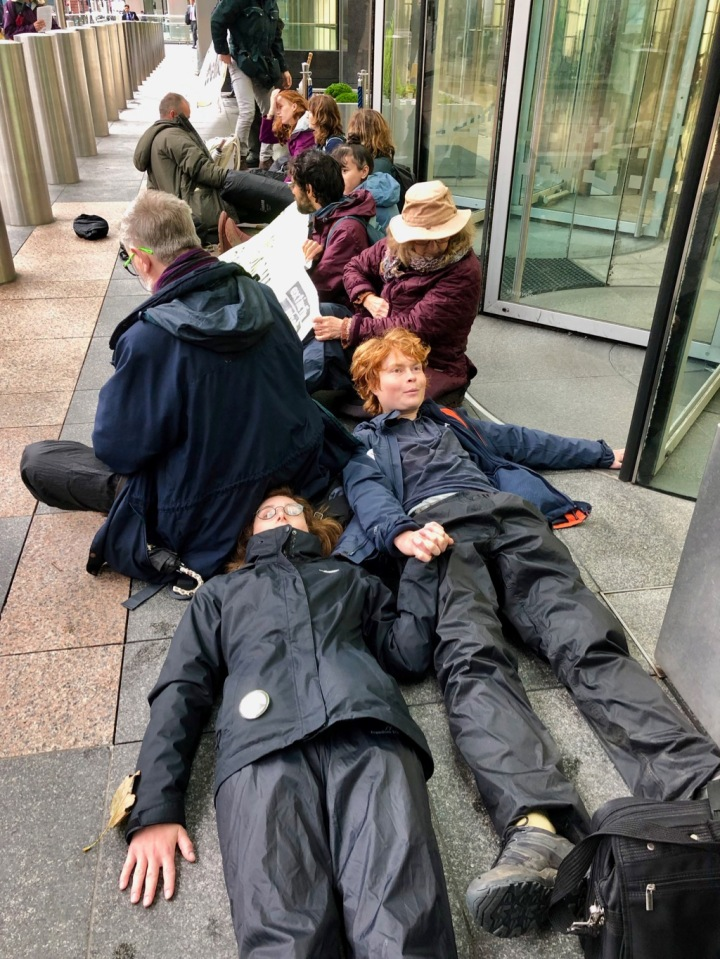 Rebels glued on outside Barclays Office in Canary Wharf