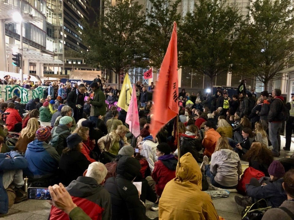 Numbers gather, with drumming and banners