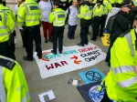 Protest against the arms trade and how war drives climate change
